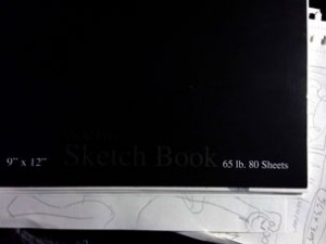 Cheap, dollar-store sketchbook = priceless. Well, a dollar, actually.